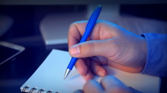 Close-up of a hand write with a pen. Stock Footage