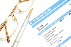 Retirement plan document with pen and glasses Stock Photos