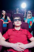 People in the cinema wearing 3d glasses - stock photo