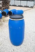 Stock Photo of Plastic Storage Drums, Blue Barrels.