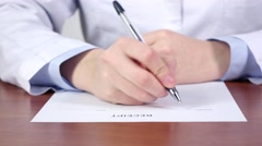 Medical diagnose, hands of doctor writing a receipt for patience - stock footage
