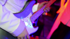 Guitarist adjusts electric guitar on stage. Performance of band Stock Footage