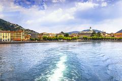 Como city in italian lake district from ferry boat. Italy. - stock photo
