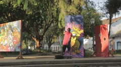 Graffiti Spray Paint in Mathris square, Paraty Rio de Janeiro Stock Footage