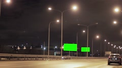 Mototrway with 2 green advert billboards, car with emergency fire. Night. Nobody - stock footage