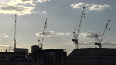 4K Aerial view construction site crane machine new building London downtown day  Stock Footage