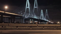 View of huge motorway bridge in night city focus out.  Illumination lights - stock footage