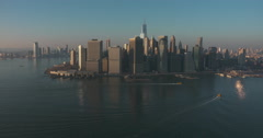 Aerial of Manhattan Financial District, Flying up the East River Stock Footage