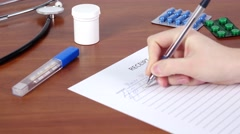 Doctor continue writing a receipt for patience - stock footage
