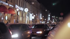 View of night road in city. Driving cars with turn left signals Stock Footage