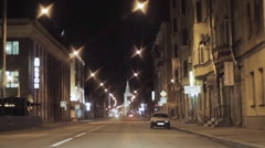 View of night city and road. Camera inside driving car Stock Footage