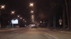 View of night city and road. Camera inside driving car. Railroad bridge Stock Footage
