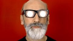Hypnoglasses smile spotlight Stock Footage