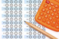 Answer sheet test score with pencil calculator Stock Photos