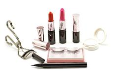 Makeup set with lipstick false lashes eyelash curler and  eyeshadow isolated Stock Photos