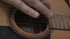 Male Playing The Acoustic Guitar In Slow Motion Stock Footage