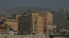 Walking on Obala Kulina bana, near the National and University Library, Sarajevo Stock Footage