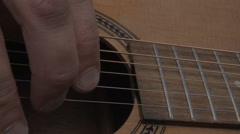 Male Playing The Acoustic Guitar In Slow Motion - stock footage