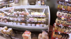 Grocery shopping at the local supermarket. Stock Footage