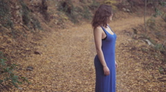Brunette barefooted looking for the mate lost her direction during a walk Stock Footage