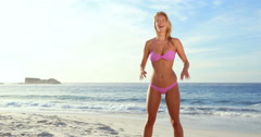 Attractive blonde playing with volleyball Stock Footage