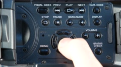 Finger pressing buttons like menu, mode, volume Stock Footage