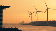Wind Turbines at a Sea Port Stock Footage