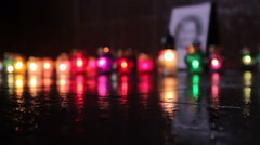 Candles in memory of Andrew Kuzmenko - stock footage