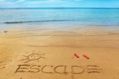 Escape message on the sand - stock photo