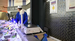 Fishmonger working in supermarket Stock Footage