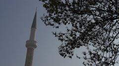 View of a white tower and a tree in Sarajevo Stock Footage