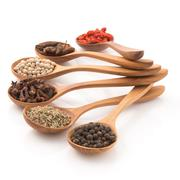 Spicy herb Insert a wooden spoon arranged to prepare food on a white backgrou - stock photo
