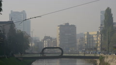 View of people on Festina Lente bridge and wires on a misty dayin Sarajevo Stock Footage