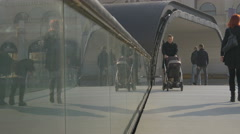 People and a man with  baby carriage walking on Festina Lente bridge in Sarajevo Stock Footage
