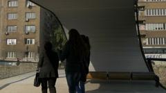 People walking on Festina Lente bridge and cars driving on  street in Sarajevo Stock Footage