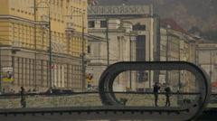 People walking, standing and talking on Festina Lente bridge in Sarajevo Stock Footage