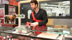 Butcher serving meat in supermarket Stock Footage