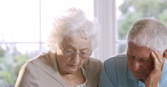Worried senior couple talking Stock Footage