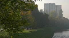 Relaxing in a park on the coast of Miljacka River, in Sarajevo Stock Footage