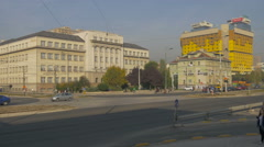 Walking and driving in front of the Technical School and Hotel Holiday, Sarajevo Stock Footage
