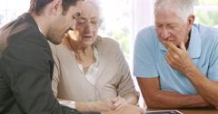 Businessman talking to senior couple Stock Footage