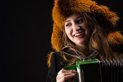 Portrait attractive smiling woman with fur hat Stock Photos