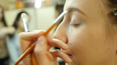 Prom makeup for cute lovely young girl - painting eyebrows with brush closeup - stock footage