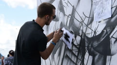 Man performing graffiti skills in the street Stock Footage