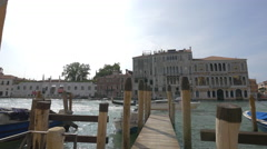 Wooden pier at the waterfront near Basilica Santa Maria della Salute in Venice Stock Footage