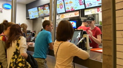 People in fast food restaurant Stock Footage