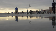 Reflection of people in a puddle of water, Venice Stock Footage