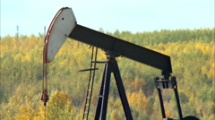 Tilt down of pump jacks working in a field for oil and gas industry. Stock Footage