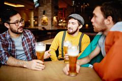 Talking in pub Stock Photos