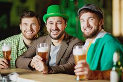 Friends sitting in pub Stock Photos